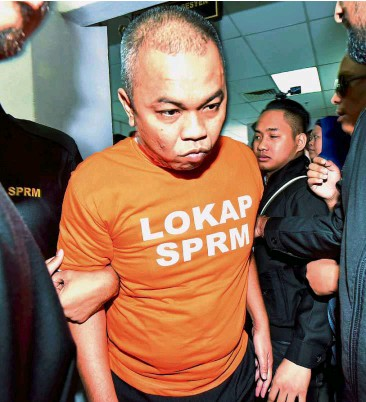 TWO IN COURT Abd Latif Above Being Brought To The Johor Baru Sessions Court By Anti Graft Officers He Is Alleged Have Abetted Property Consultant