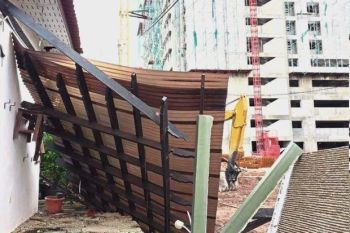 Wall and awning collapsed in house near construction site