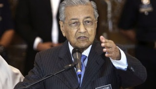 Malaysia's PM Dr Mahathir visits China to push forward bilateral ties and witness signing of 3 MoUs