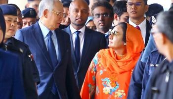 Najib & his strong wife Rosmah with 17 charges in Court over money laundering